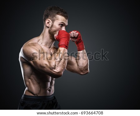 MMA Fighter Preparing Bandages For Training. Royalty-Free Stock Photo #693664708