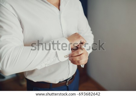 Man takes on the cufflinks #693682642