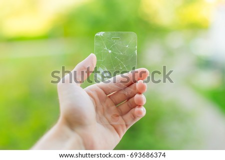 broken protective glass on green background #693686374