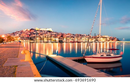 Splendid spring seascape on Aegean Sea. Colorful evening view of Kavala city, the principal seaport of eastern Macedonia and the capital of Kavala regional unit. Greece, Europe. Royalty-Free Stock Photo #693691690