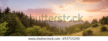 Amazing mountain landscape with colorful vivid sunset on the cloudy sky, natural outdoor travel background. Beauty world. #693715240