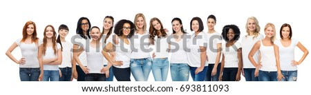 friendship, diverse, body positive and people concept - group of happy different age and ethnicity women in white t-shirts hugging Royalty-Free Stock Photo #693811093