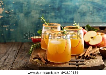 Hard apple cider cocktail with fall cinnamon, cardamom and star anise #693822154