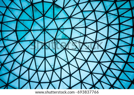 Curved Blue Glass Roof or Ceiling of Dome with Geometric Structure Black Steel in Modern and Contemporary Architecture Style as abstract architectural and industrial background or pattern #693837766