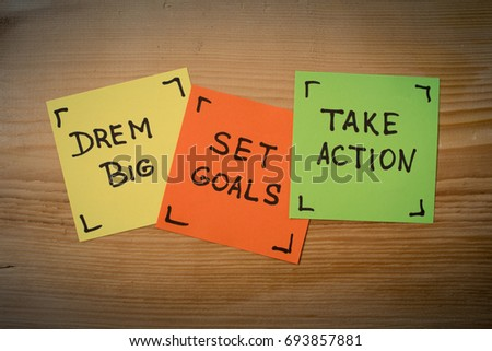 Dream big, set goals, take action, success recipe on wooden background. dream big, set goals, take action - motivational advice or reminder on colorful sticky notes against rustic wood #693857881