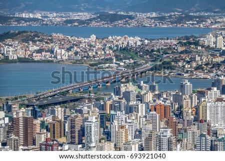 Aerial view of Dowtown Florianopolis City and Pedro Ivo Campos Bridge - Florianopolis, Santa Catarina, Brazil #693921040