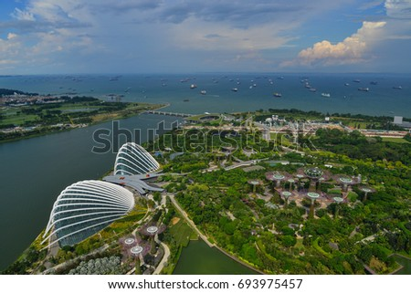 Singapore - Jun 13, 2017. Aerial view of Gardens by the Bay in Singapore. Gardens by the Bay is a huge, colourful, futuristic park in the bay area of Singapore. #693975457