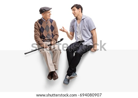Senior and a young man sitting on a panel and talking isolated on white background Royalty-Free Stock Photo #694080907