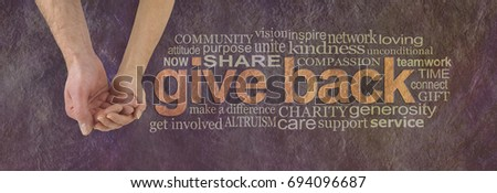 Please donate to our cause - campaign banner with female hand holding male cupped hand on left and a GIVE BACK word cloud  on right against a rustic parchment background Royalty-Free Stock Photo #694096687