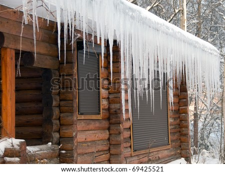 Icicles on a roof Royalty-Free Stock Photo #69425521