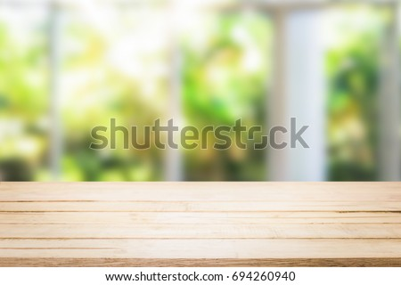 wooden table in the kitchen on the window background in the morning. #694260940