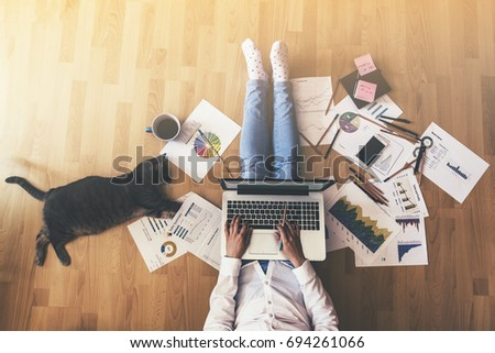 Creative space - Girl with her cat working #694261066