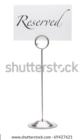 A reserved sign in a stainless steel card holder stand. Isolated on a pure white background.