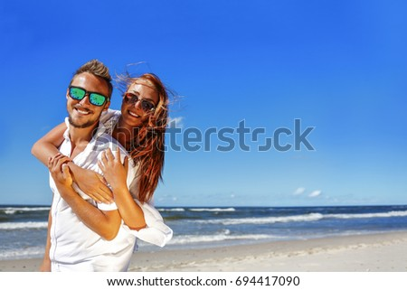 two lovers in white clothes on beach and summer time  #694417090