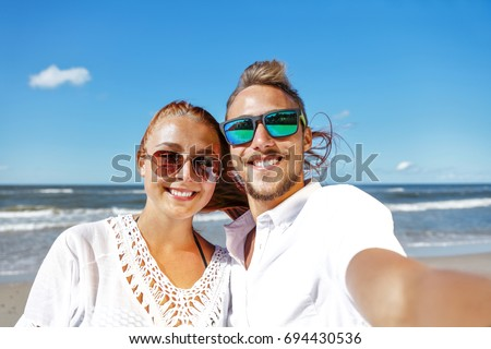 two lovers on beach and summer time  #694430536
