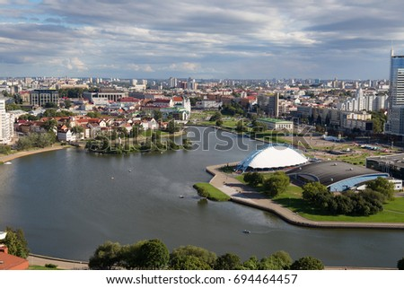 Aerial view of the south part of the Minsk with Trinity Hill, Liberty Square, Palace of Sport and Svislach River. Minsk is the capital and largest city of Belarus.  #694464457