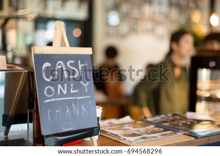 Selected focus cash only letter showing on counter consumer purchases using money #694568296