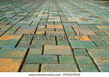 Background of yellow and green paving stones #694624036