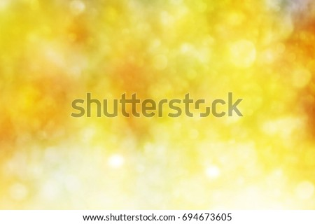 Blurred bright autumn background. Abstract colorful bokeh