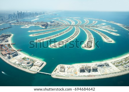 An Artificial Jumeirah Palm Island On Sea, Dubai, United Arab Emirates Royalty-Free Stock Photo #694684642