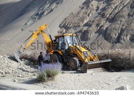 27June2017 .Leh,Jammu& Kashmir, India.Men are working during land slide and blocks on Diskit-Turtuk highway. #694743610