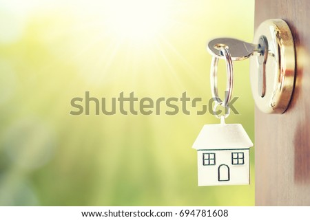 House key in the door Royalty-Free Stock Photo #694781608