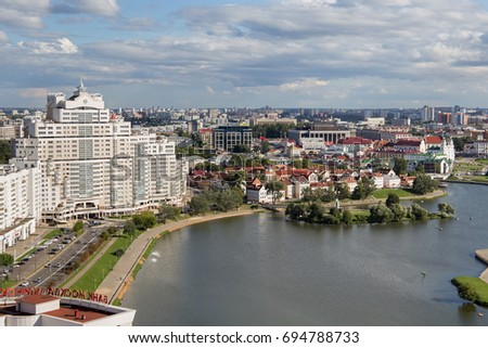 MINSK, BELARUS - AUGUST 15, 2016: Aerial view of the south part of the Minsk with Trinity Hill, Liberty Square and Svislach River. Minsk is the capital and largest city of Belarus.  #694788733