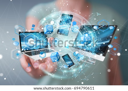 Tech devices connected to each other by businesswoman on blurred background 3D rendering #694790611