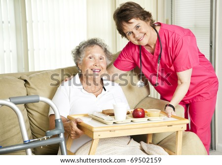 Friendly nurse brings a mean to an elderly shut-in.  Could also be lunch time at the nursing home. #69502159