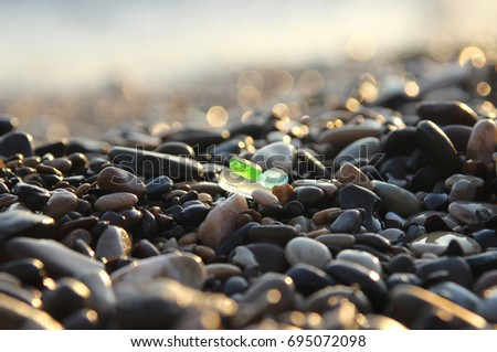Sea shore and sea glass.  #695072098
