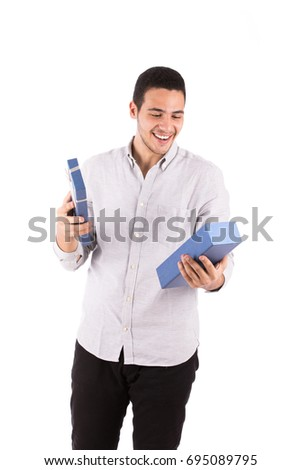 Handsome happy young man smiling and opening a blue gift box, guy wearing white shirt and black trousers, isolated on white background #695089795