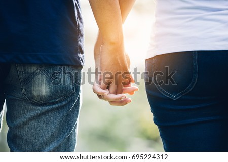 Couples holding hands.Summer in love #695224312