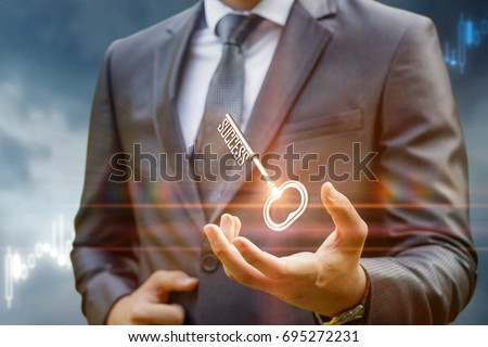Key to success in businessman hand on background of the sky. #695272231