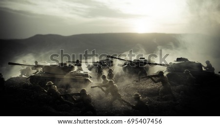 War Concept. Military silhouettes fighting scene on war fog sky background, World War Soldiers Silhouettes Below Cloudy Skyline At night. Attack scene. Armored vehicles. Tanks battle. Decoration #695407456