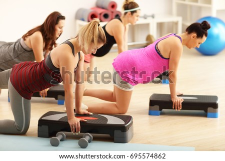 Group of pregnant women during fitness class #695574862