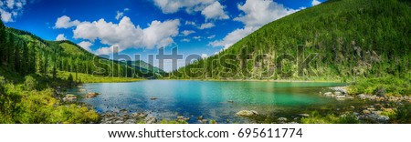 Panoramic view on mountain lake in front of mountain range, national park in Altai republic, Siberia, Russia #695611774