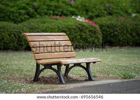 one bench in the garden, quiet peaceful resting, with copy space on Right side.