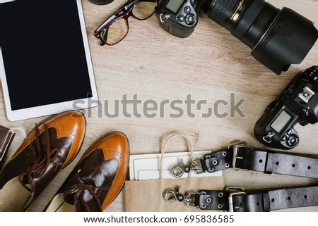 Photography hipster work table set with tablet, film, vintage shoes, lenses, supplies and digital film cameras. Top view with copy space #695836585