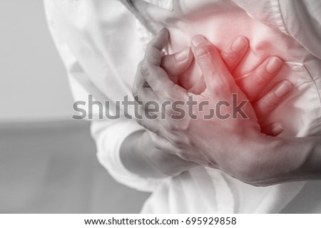 Man clutching his chest from acute pain.Heart attack symptom-Healthcare and medical concept. #695929858