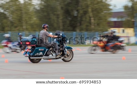 MINSK, REPUBLIC OF BELARUS - AUGUST 08, 2017: MotoGymkhana-Minsk motorcycle driving competition. Leaders around cones and artificial obstacles. Texture speed-effect with blur background. #695934853