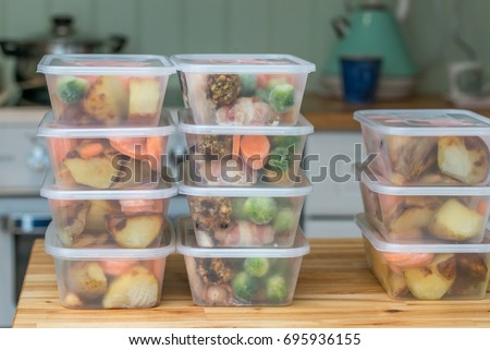 Meal prep. Stack of home cooked roast chicken dinners in containers ready to be frozen for later use as quick and easy ready meals. #695936155