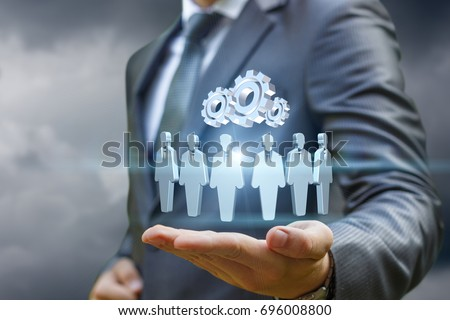 Customers and the mechanism in the hands of a business man . Royalty-Free Stock Photo #696008800