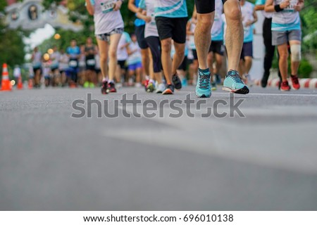 Group of people running race marathon. #696010138
