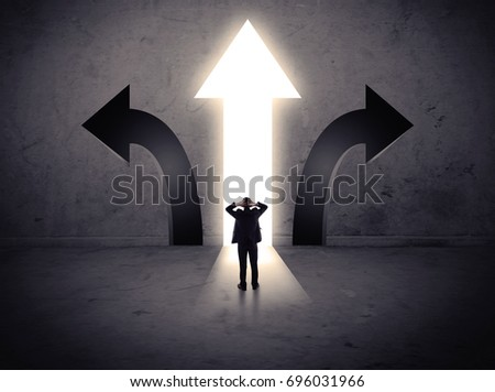 A businessman in doubt, having to choose between three different choices indicated by arrows pointing in opposite direction concept #696031966