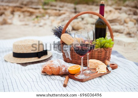 Summer Picnic on the beach at sunset in the white plaid, food and drink conception. #696036496