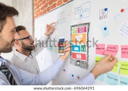 Designers man drawing website ux app development. User experience concept. Royalty-Free Stock Photo #696064291