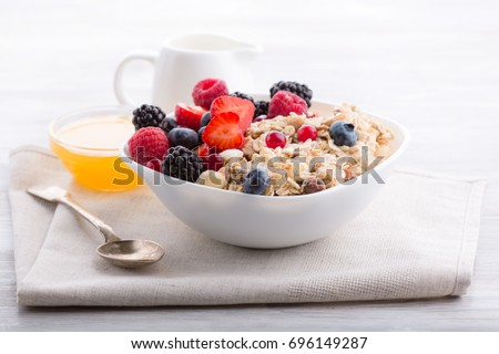 Healthy breakfast. Oatmeal with berries and honey. Royalty-Free Stock Photo #696149287