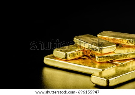 close up pure gold bar ingot put on the black color leather surface background represent the business and finance concept idea #696155947