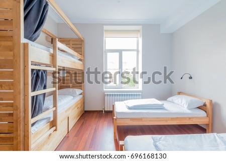 Hostel dormitory beds arranged in room #696168130