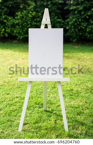 Blank easel template in the garden